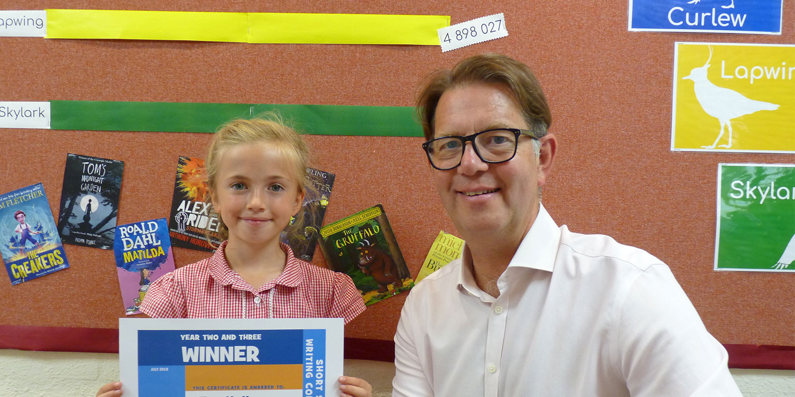 A Schoolsworks pupil receives her certificate from CEO Chris Seaton