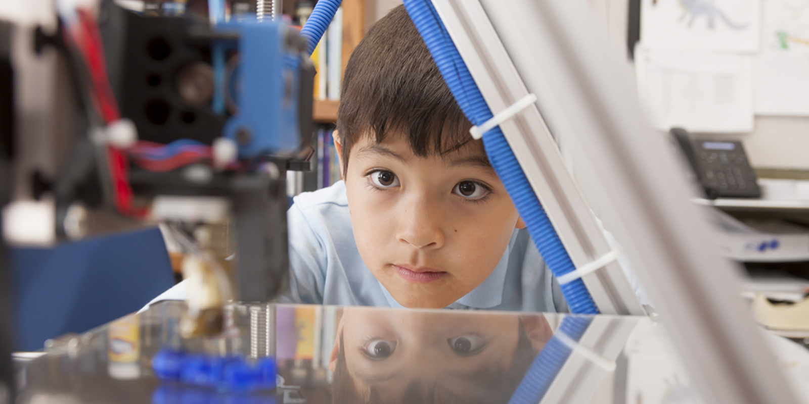 Boy looking at Science Equipment