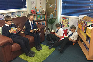 Students from Shibden Head Primary Academy reading books on World Book Day