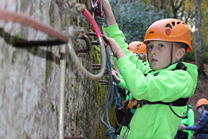Boy climbing at Beaudesert Outdoor Activity Centre