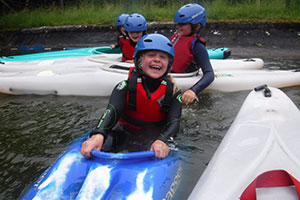 Children in boats at Longtown Outdoor Learning Centre