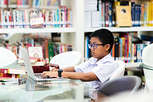 Growing your ICT provision effectively - a boy on laptop