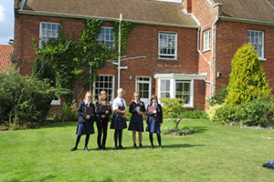 Group of students outside of the The Red House, Aldeburgh