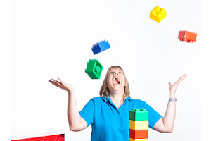 Woman playing with Thera-Build® lego blocks