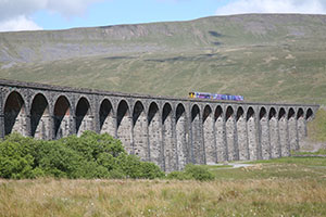 Settle-Carlisle railway train going through Ribblehead - the perfect school trip