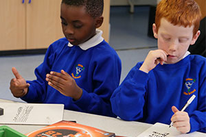 Two boys in blue jumpers using Power Maths mastery resource