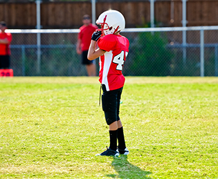A pupil in American football kit