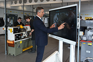 Aston University Engineering Academy - a teacher uses a large touch-screen device