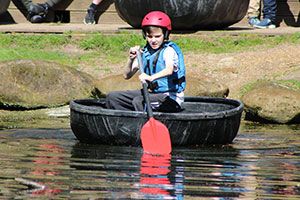 Boy on boat at Beaudesert Outdoor Activity Centre