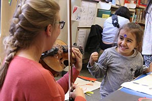 child making music with BCMG awarded grant