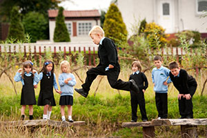 Children playing on school grounds - Learning Through Landscapes