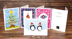 Children design their own Christmas Cards & Gifts. We Print. You Fundraise