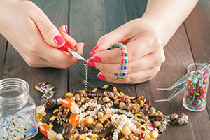 A female student making jewellery - careers advice is offered in the article