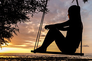 A girl on a swing – Hypnotherapy addresses child mental health issues via daydreaming and relaxing