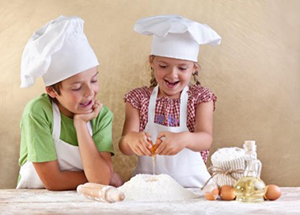 two girls learning how to cook with STEM
