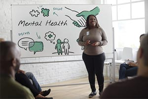 Woman taking part in mental health activity