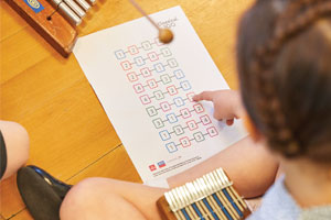 Young girl using classic music resources in classroom