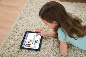 Child using tablet for communication