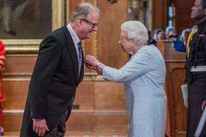 Nigel getting his OBE from the Queen