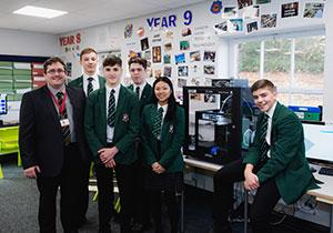 Teacher & students with 3D Printer in school